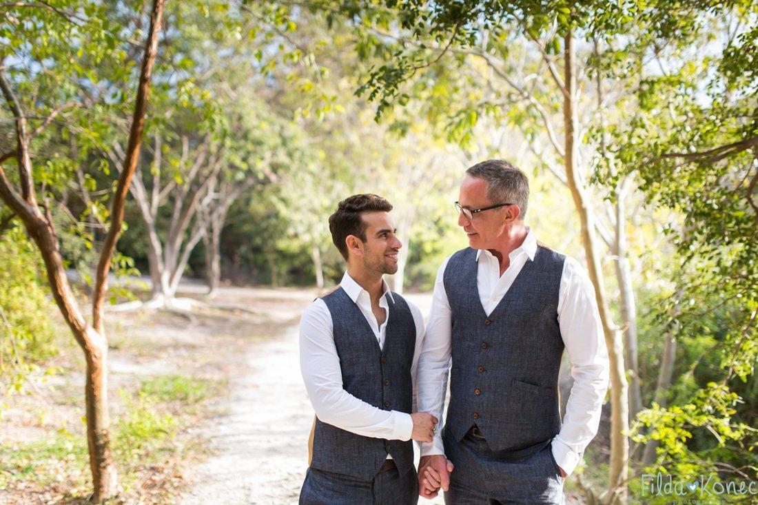 same sex couple posing for their wedding photo