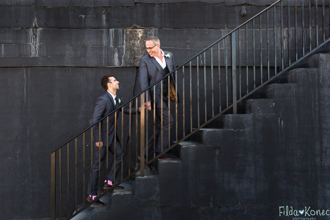gay couple on stairs at fort zachary taylor