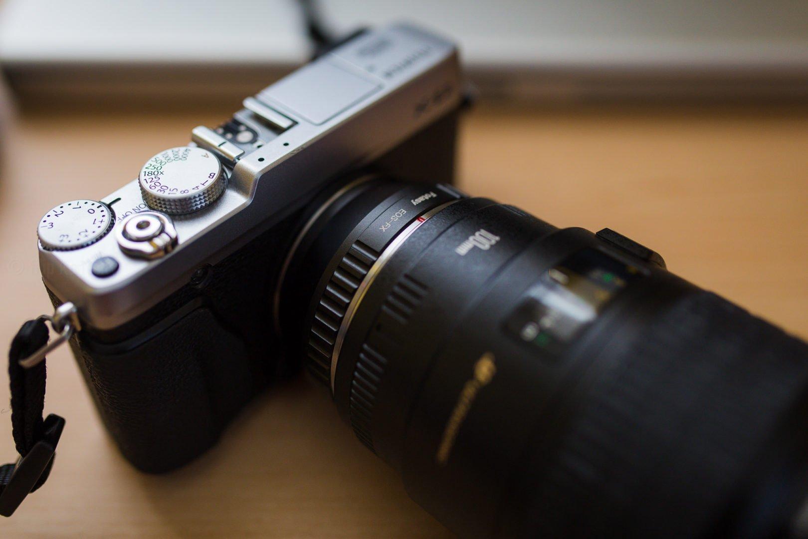 closeup of canon macro lens on fujifilm camera
