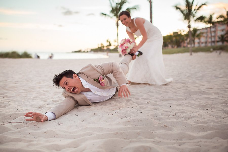 bride pulling grooms leg on beach in key west florida
