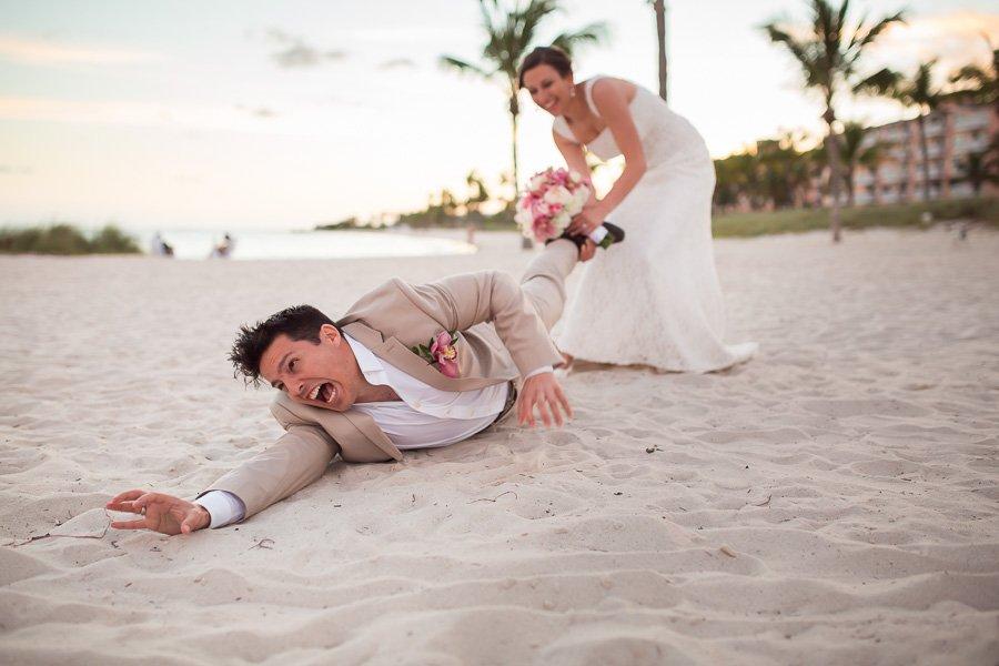 bride pulling grooms leg on beach in key west florida
