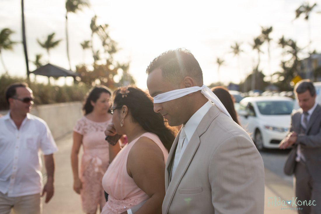 groom is blindfolded so he doesn't see his bride