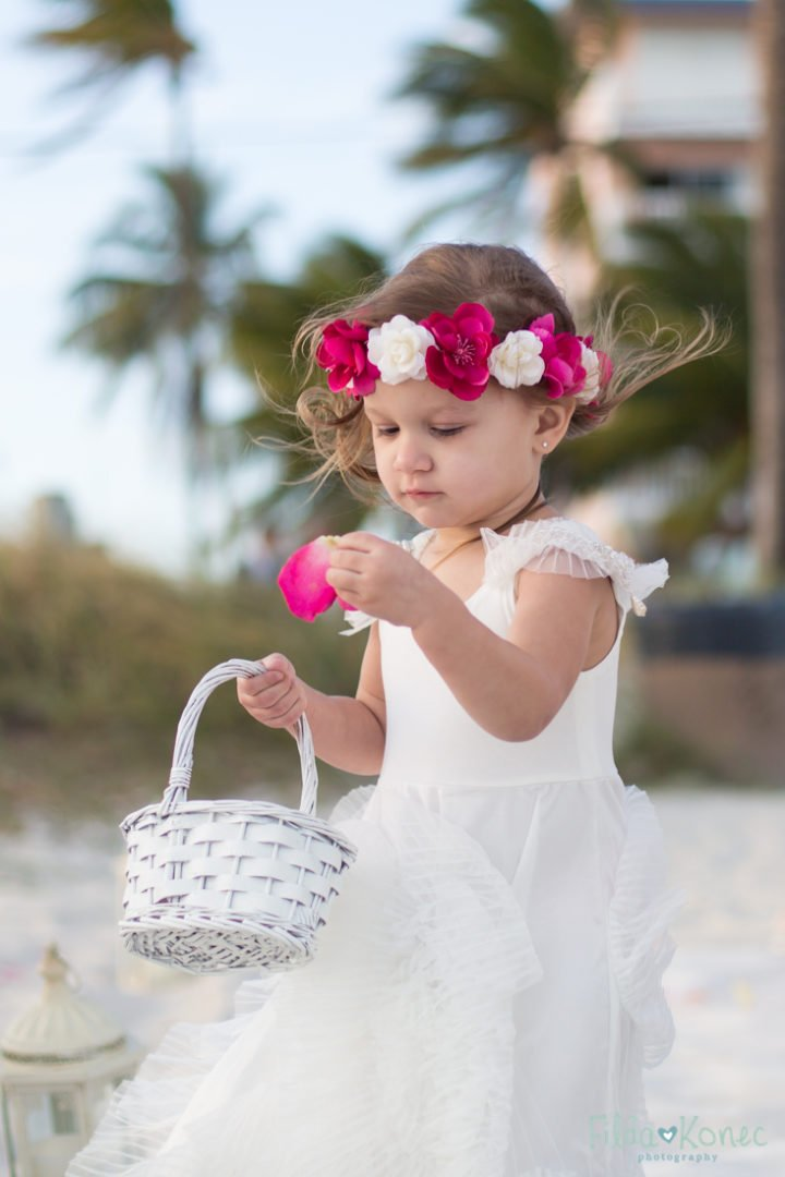 little flower girl throws petals during beach ceremony in key west florida