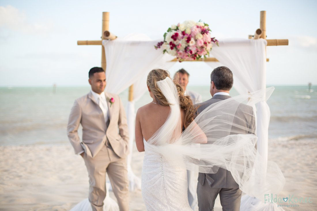 bride and her father walking down the isle on the beach in key west florida