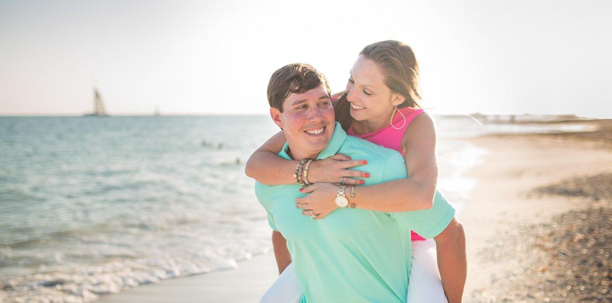 girl and boy having fun during their beach photo shoot in key west florida