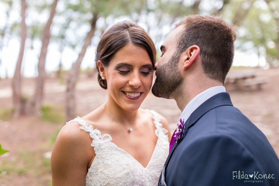 bride and groom have an intimate moment at fort zachary in key west, florida