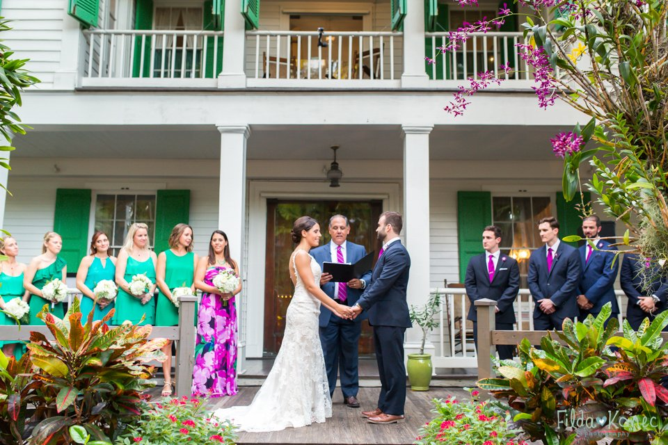 bride and groom during their ceremony at audubon house in key west, florida