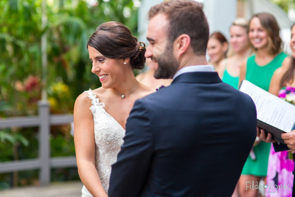 bride and groom laughing during their ceremony