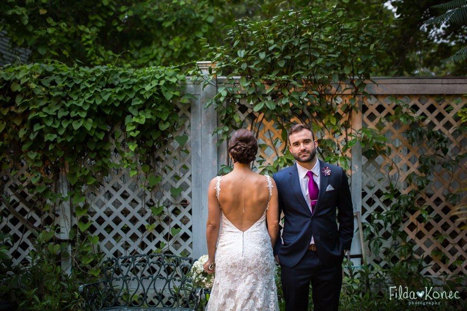 newlyweds posing for photo at audubon house garden