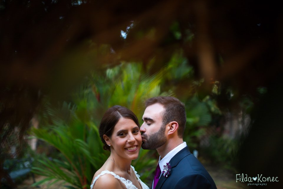 husband kissing his wife at audubon house in key west, florida