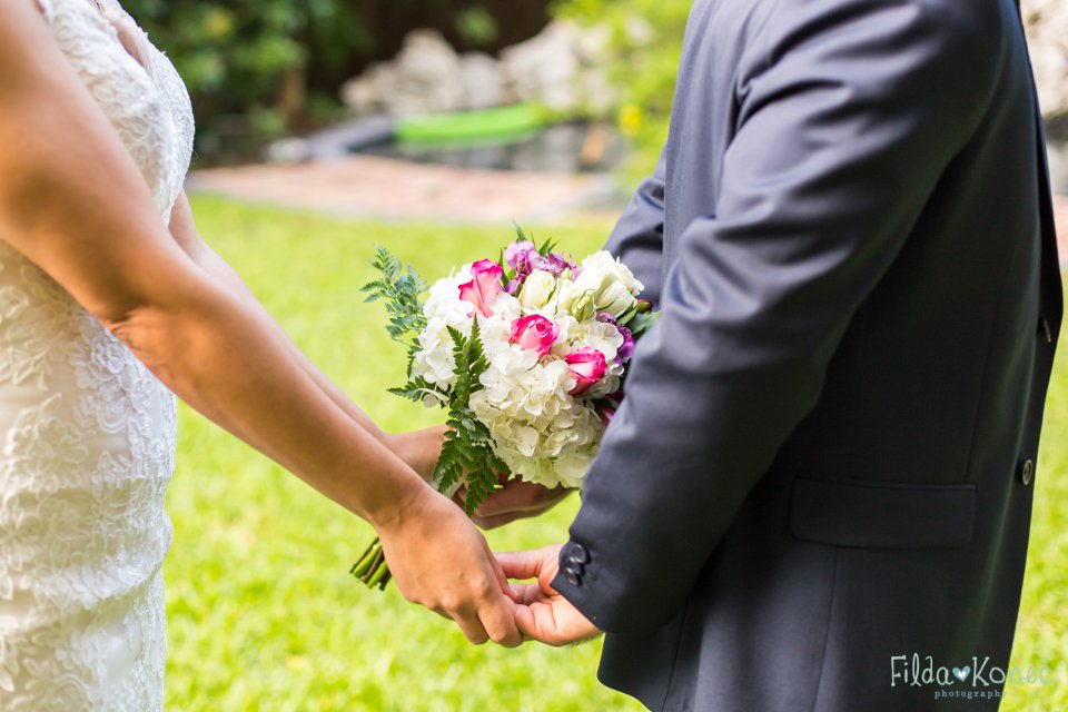 bride and groom touching hands close up