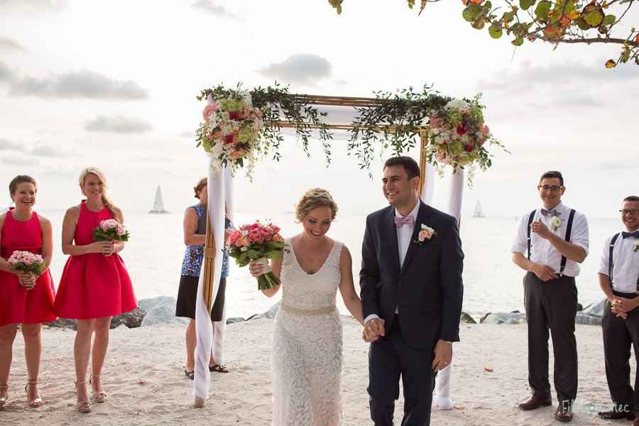 bride and groom at fort zachary taylor beach in key west florida