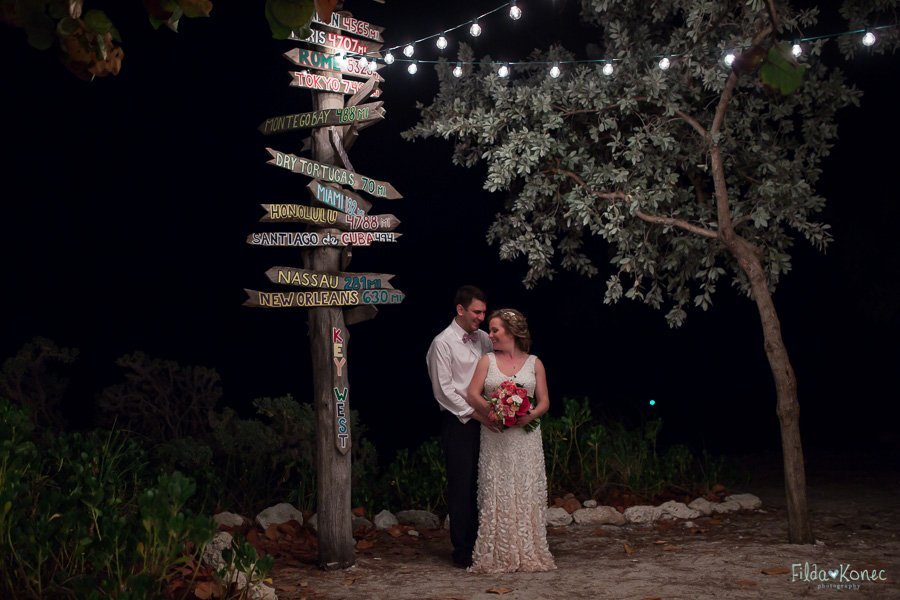 bride and groom at fort zachary taylor beach sign in key west florida
