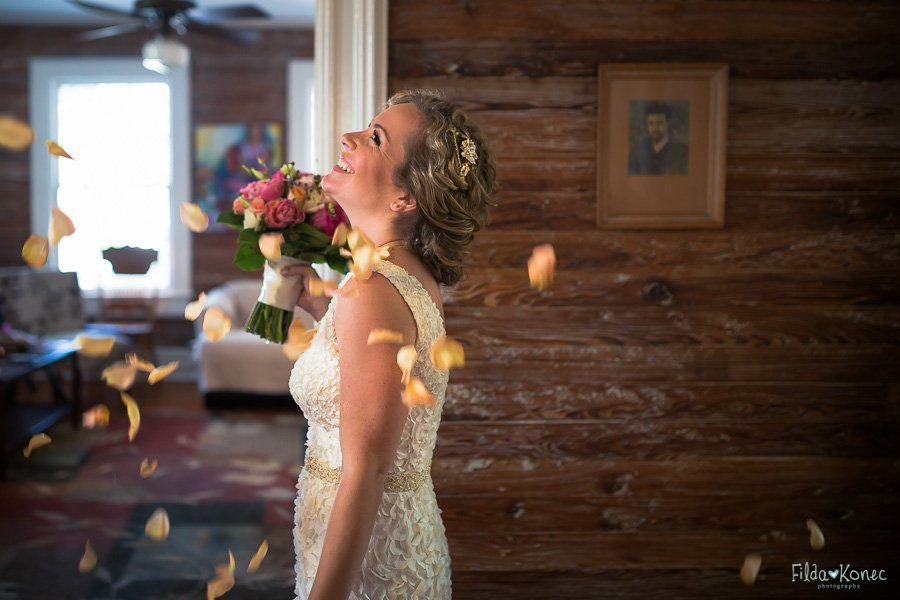 bride with flying rose petals