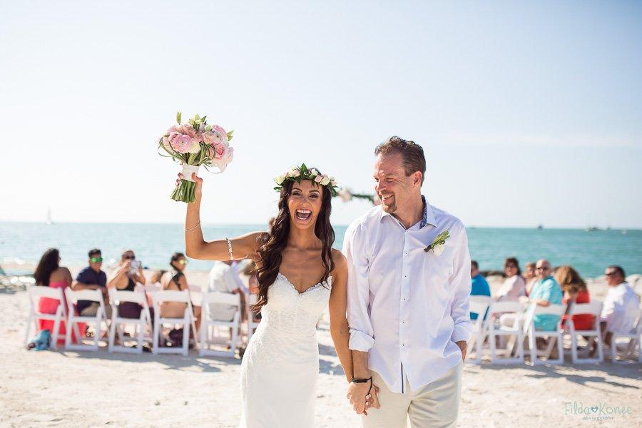 couple walking out the isle happy and emotional on sunset key florida