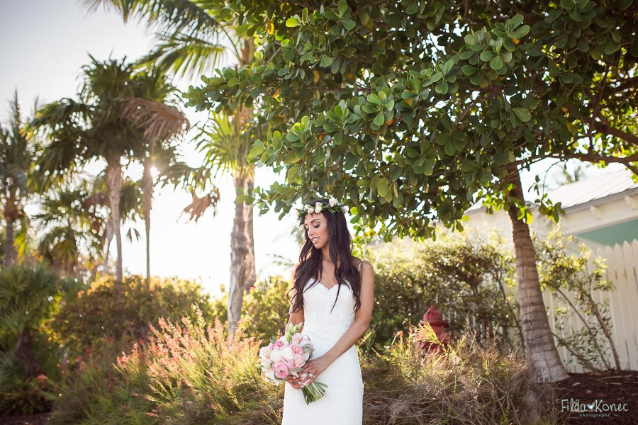 bride posing with beautiful foliage at sunset key key west florida