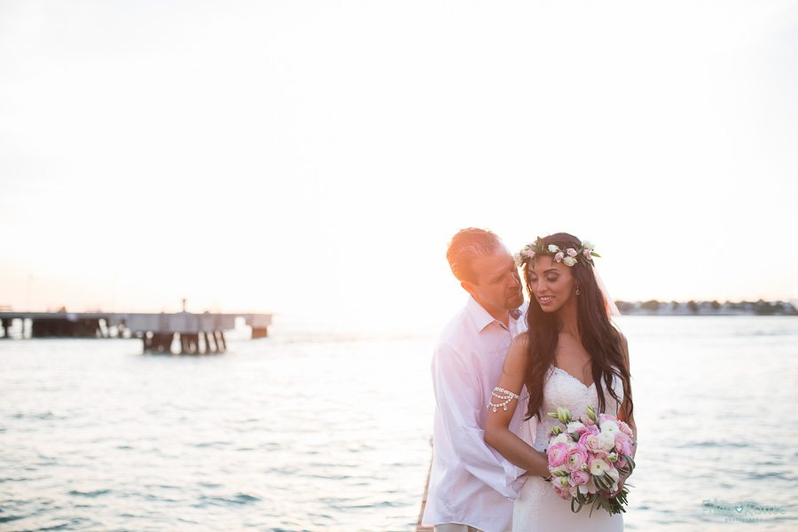 westin pier in key west florida with bride and groom at sunset