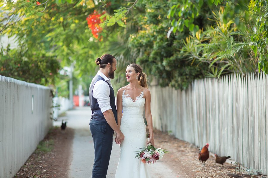 downtown key west florida street shot with bride and groom and roosters