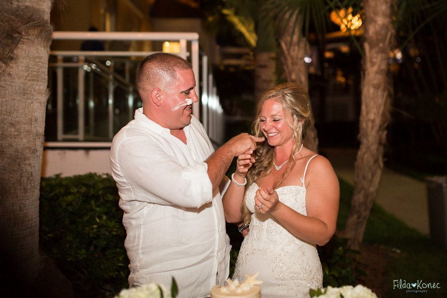 bride and groom eat their wedding cake on their beach wedding in key west