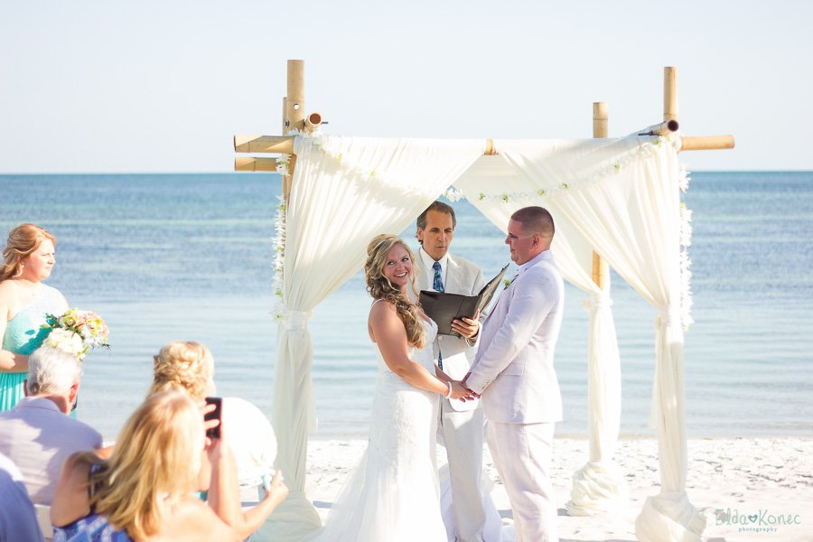 bride and groom at beach altar in key west