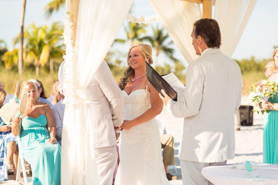 bride looks at her groom during their beach wedding in key west