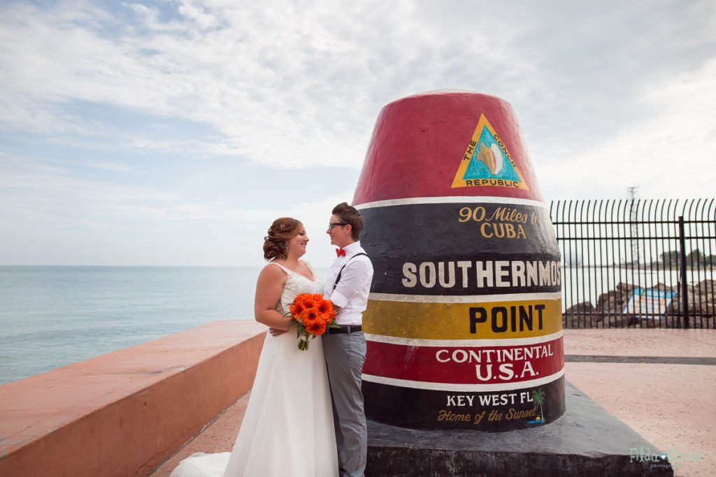 bride and groom at southernmost point in key west