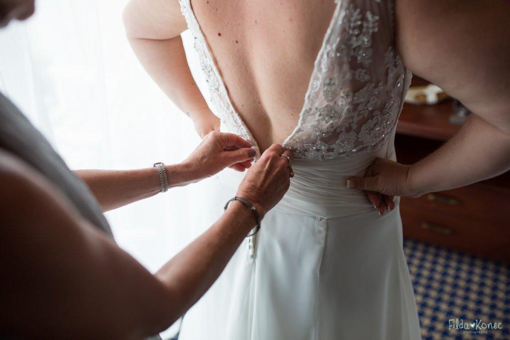 bride putting her bridal dress on