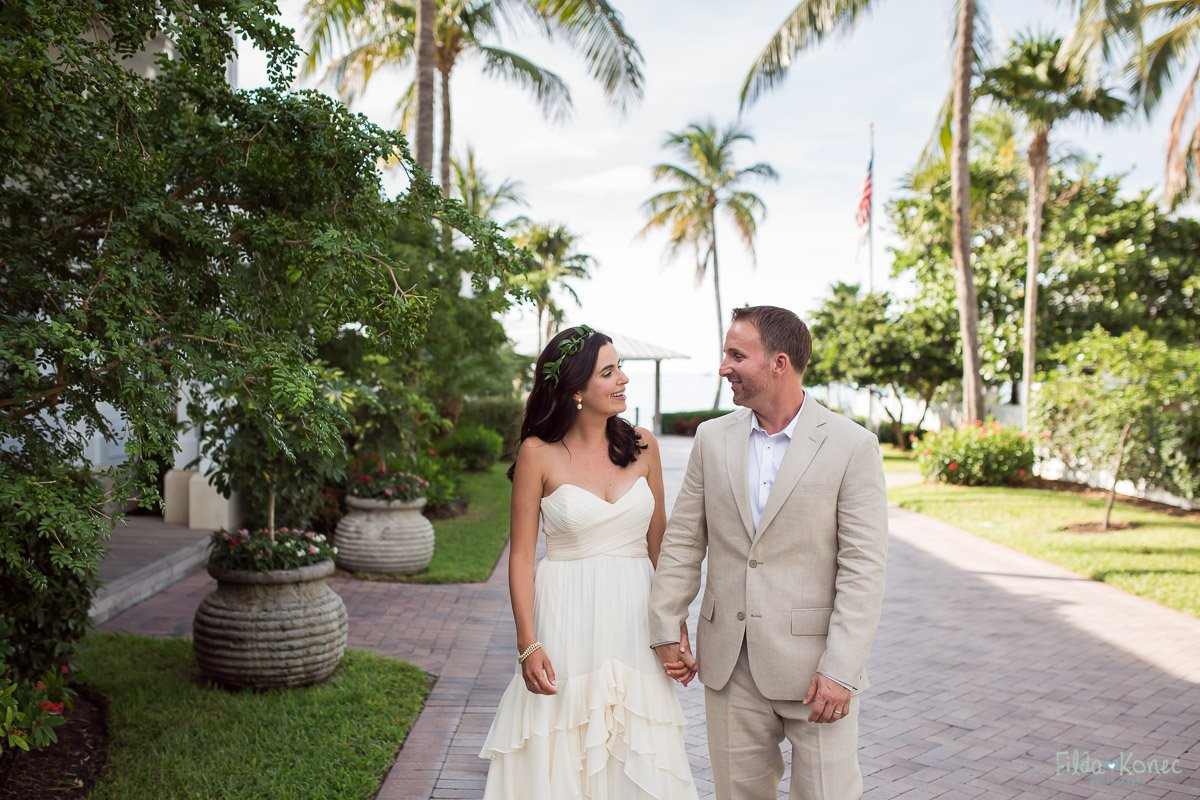 bride and groom walking on sunset key island