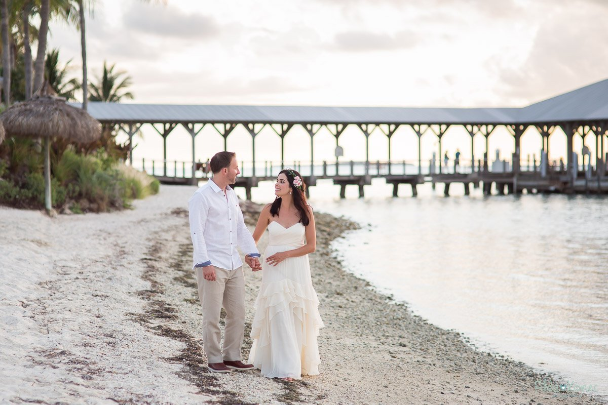 bride and groom on the beach at sunset key island