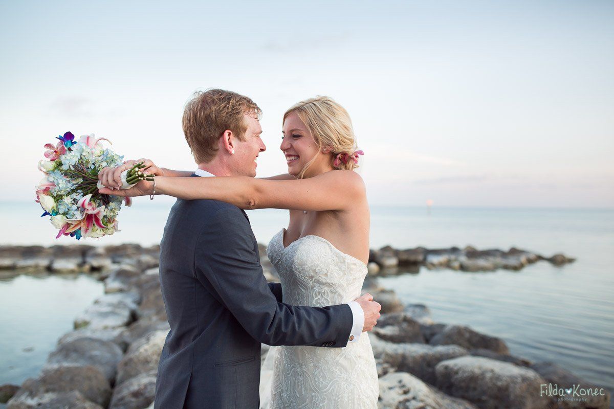 bride and groom with ocean