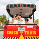 bride and groom on conch train