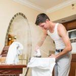 groom irons his shirt