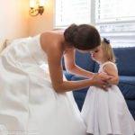 bride hugs little girl
