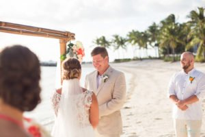 groom smiles at his bride