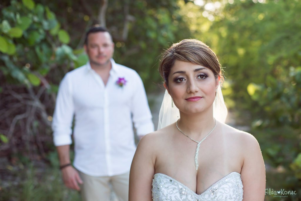 bride with groom in the background