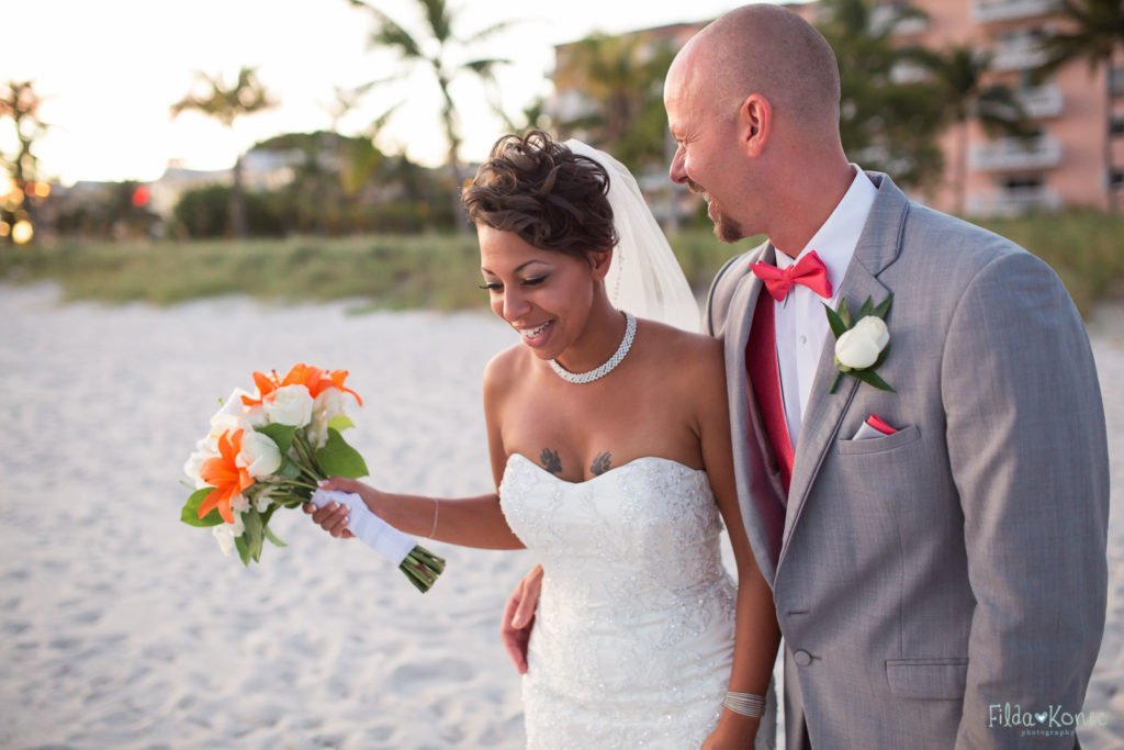 Married couple laughs on their wedding day in Key West, FL
