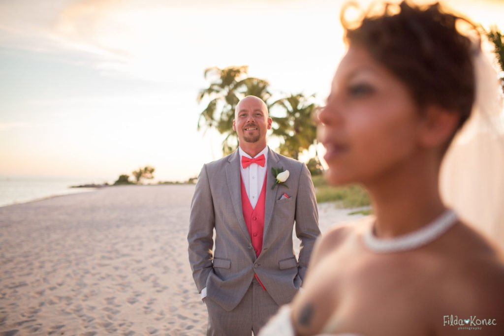 Groom on Smather's beach with bride in the foreground