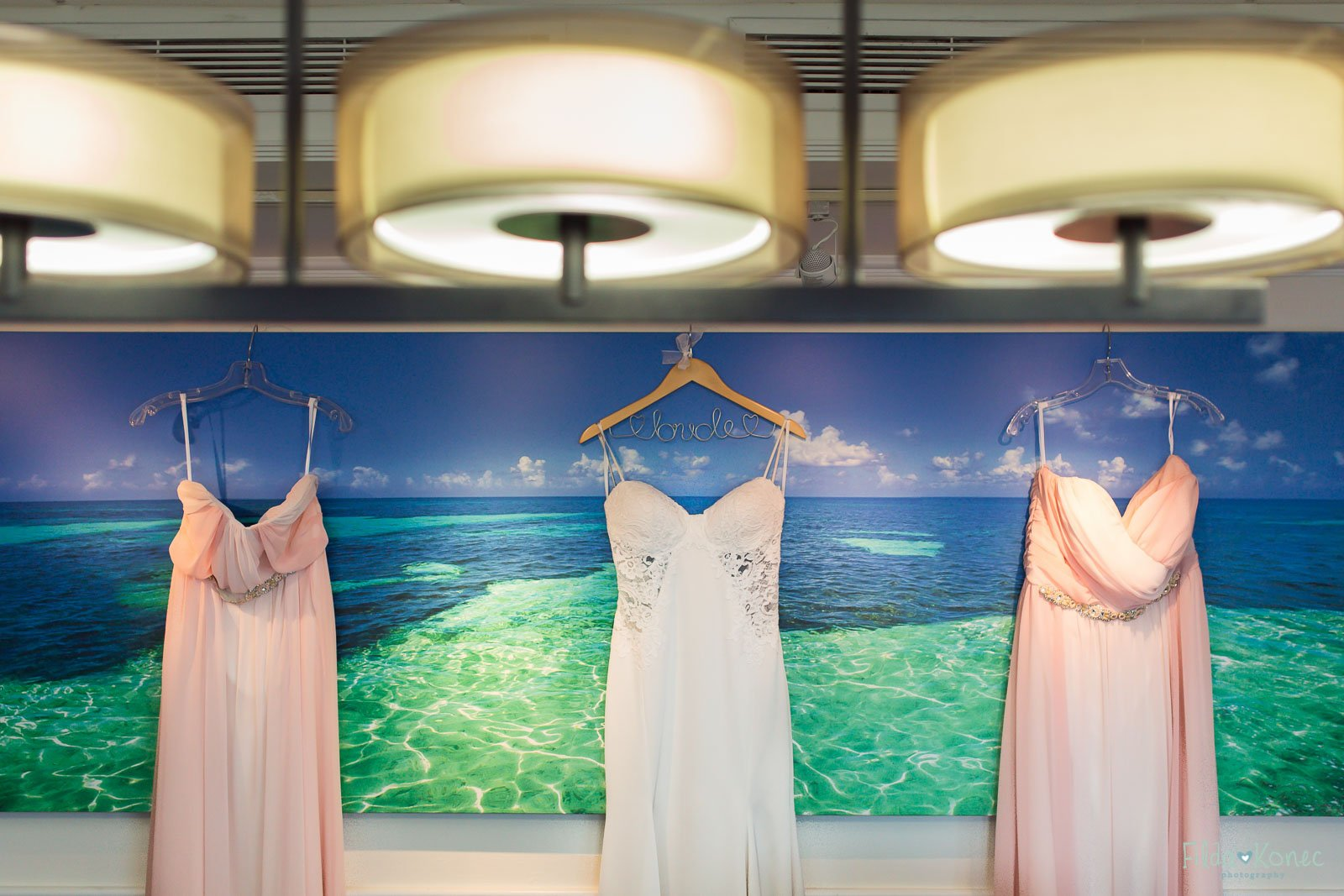 wedding and bridesmaids dress hanging on the wall