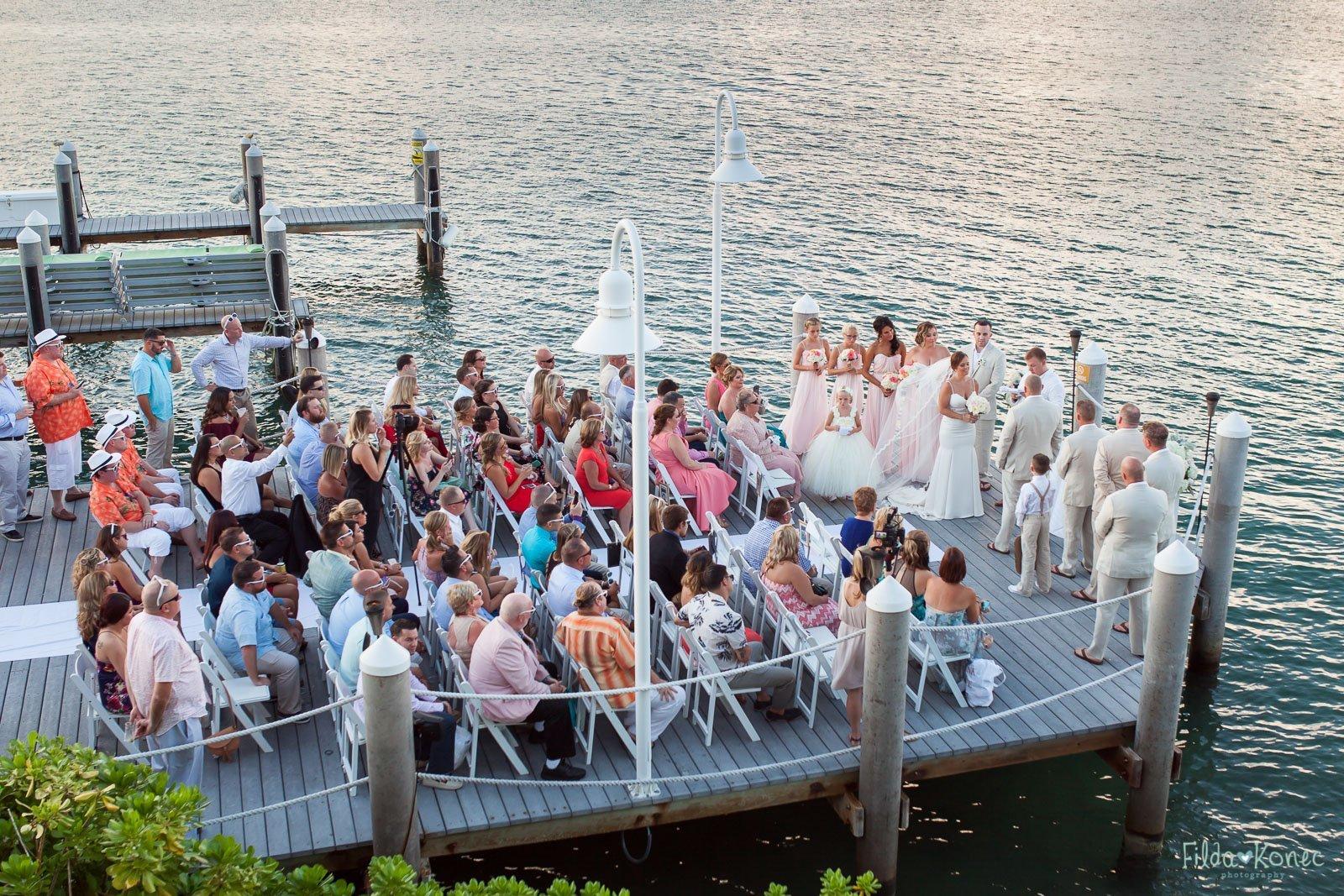 wide shot of the dock wedding ceremony at hyatt in key west