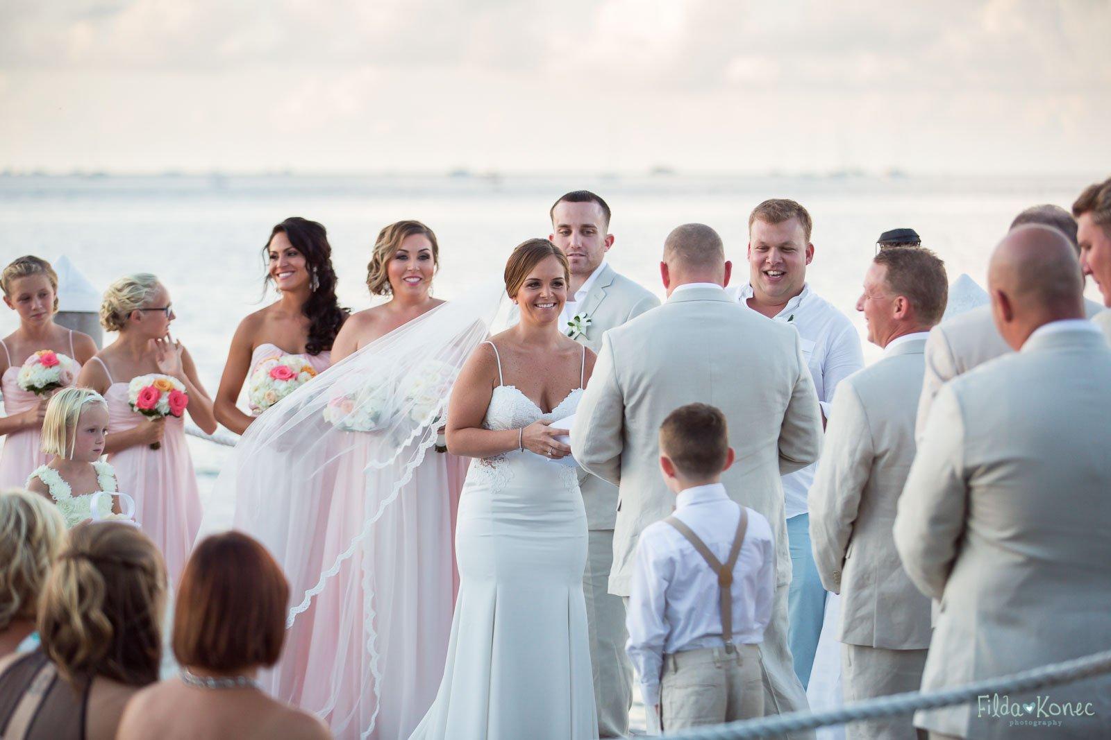 bride is smiling at her groom during their key west hyatt wedding