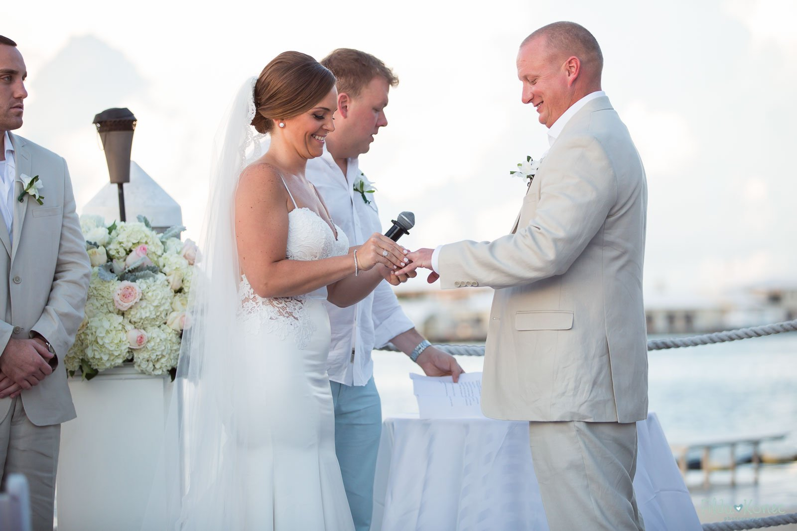 ring exchange during their waterfront key west ceremony
