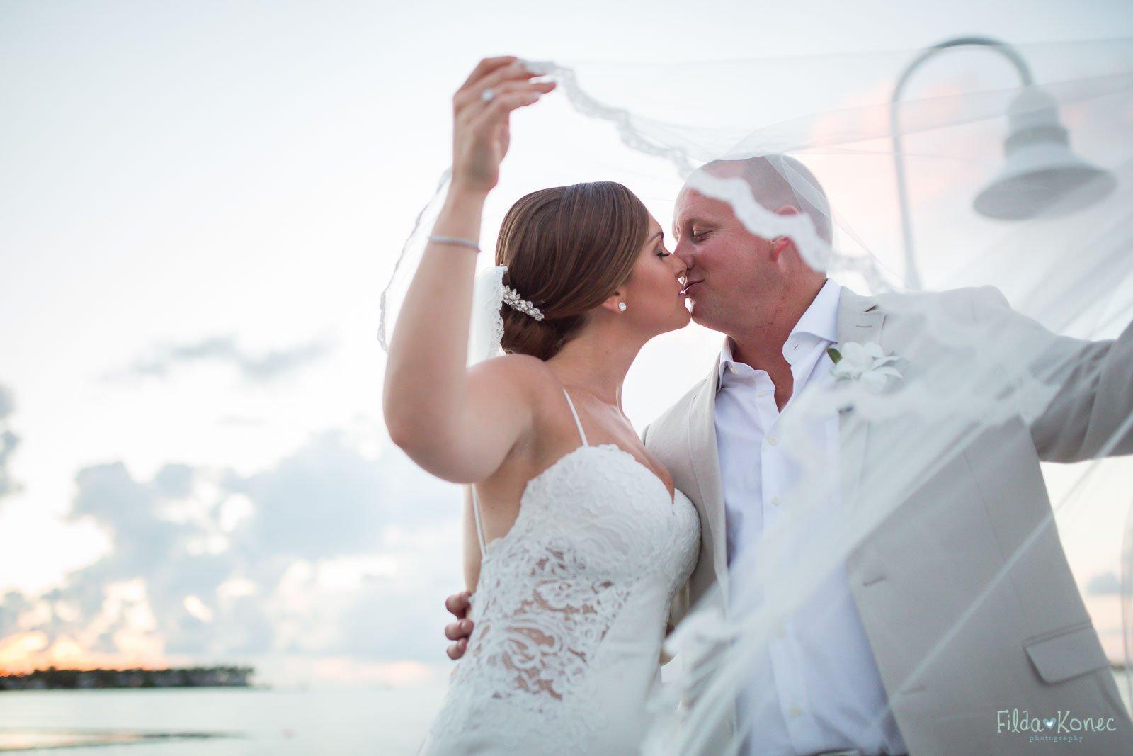 kiss under the veil near water at hyatt in key west