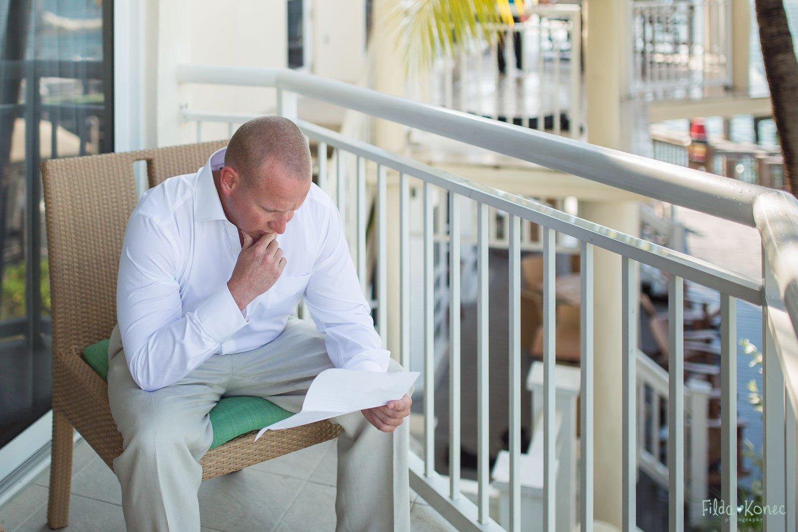 groom reading a letter before his key west wedding at hyatt