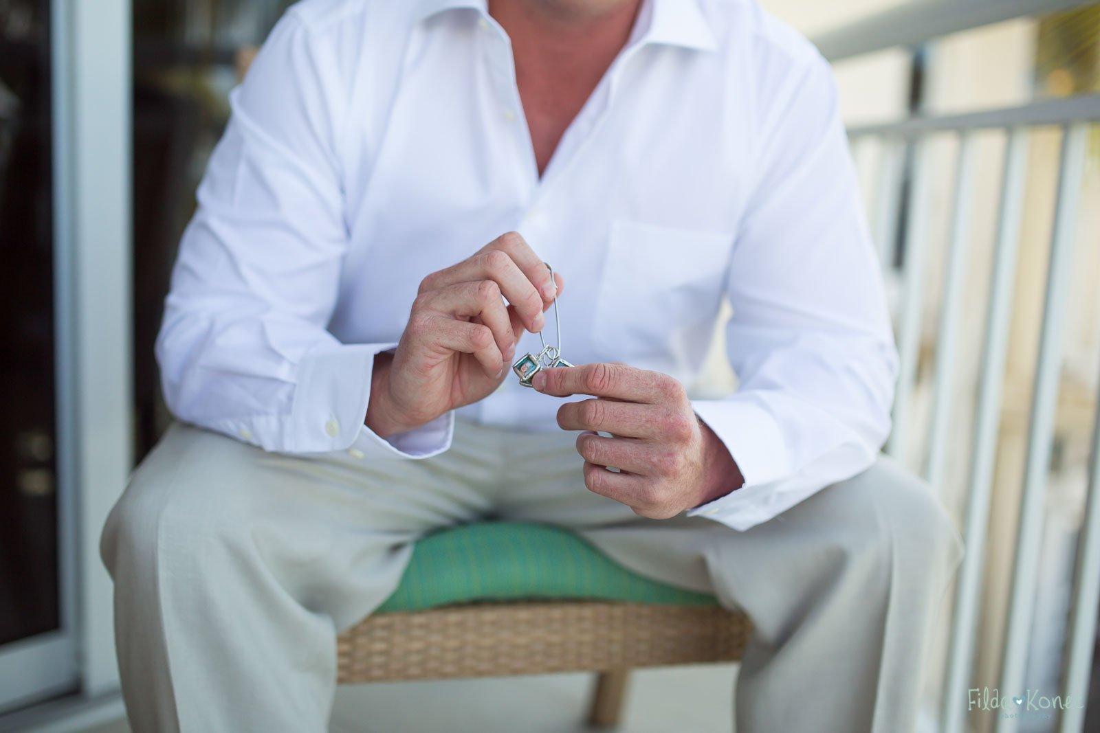 groom showing jewelry