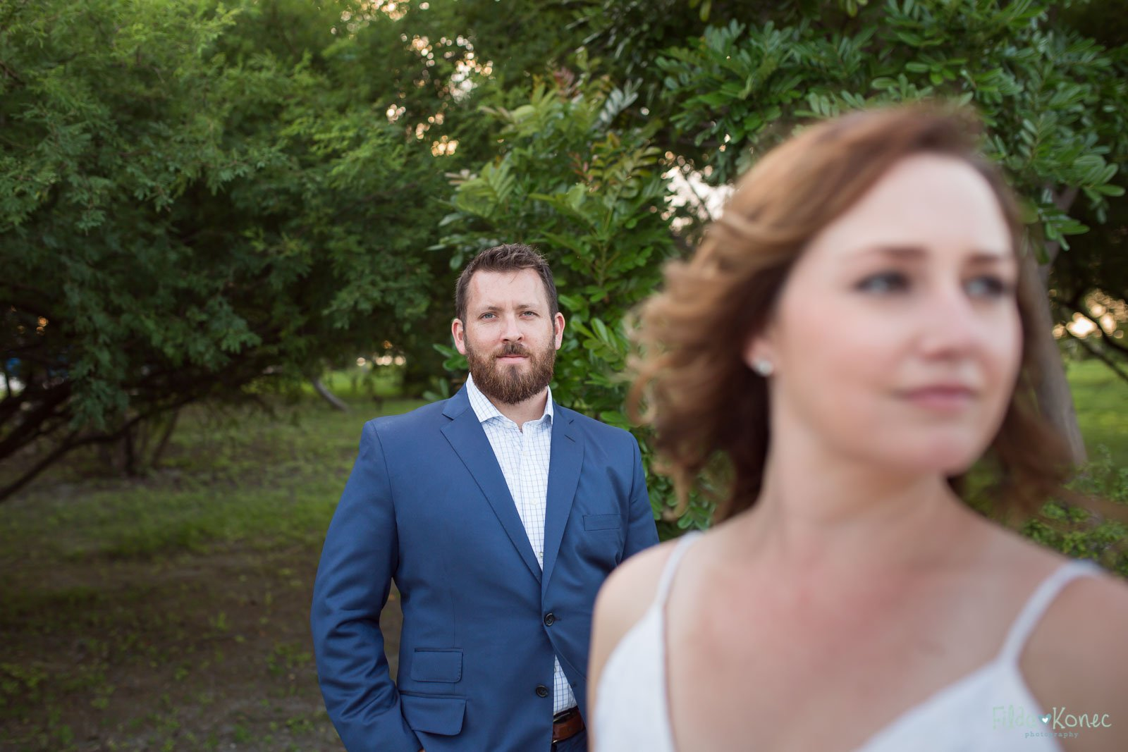 portrait of groom with bride in the foreground
