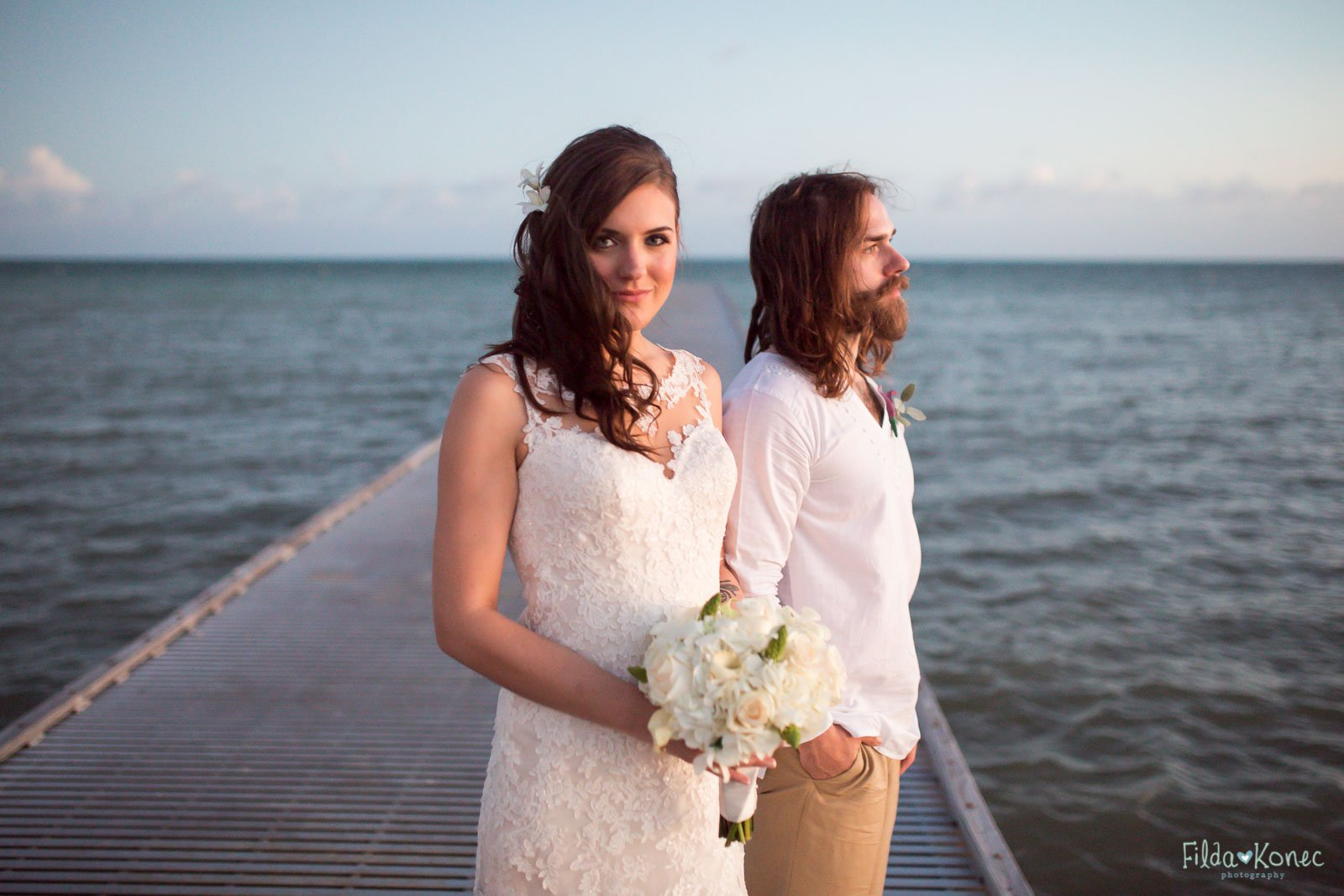 couple on higgs beach pier in key west florida after sunset