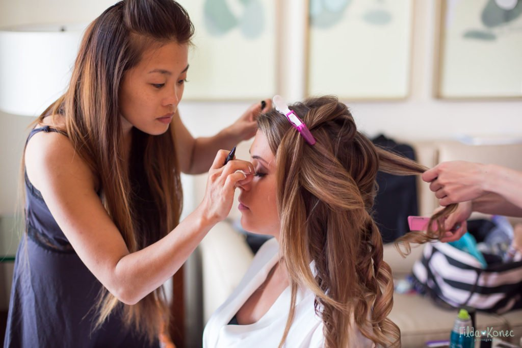 make up artist working on brides makeup