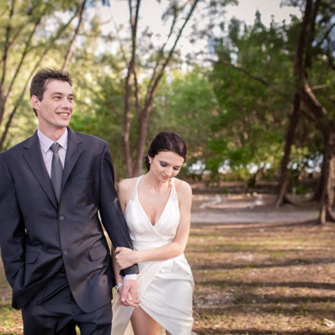 bride and groom walk in the park in florida