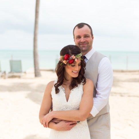 couple on the beach at southernmost beach hotel