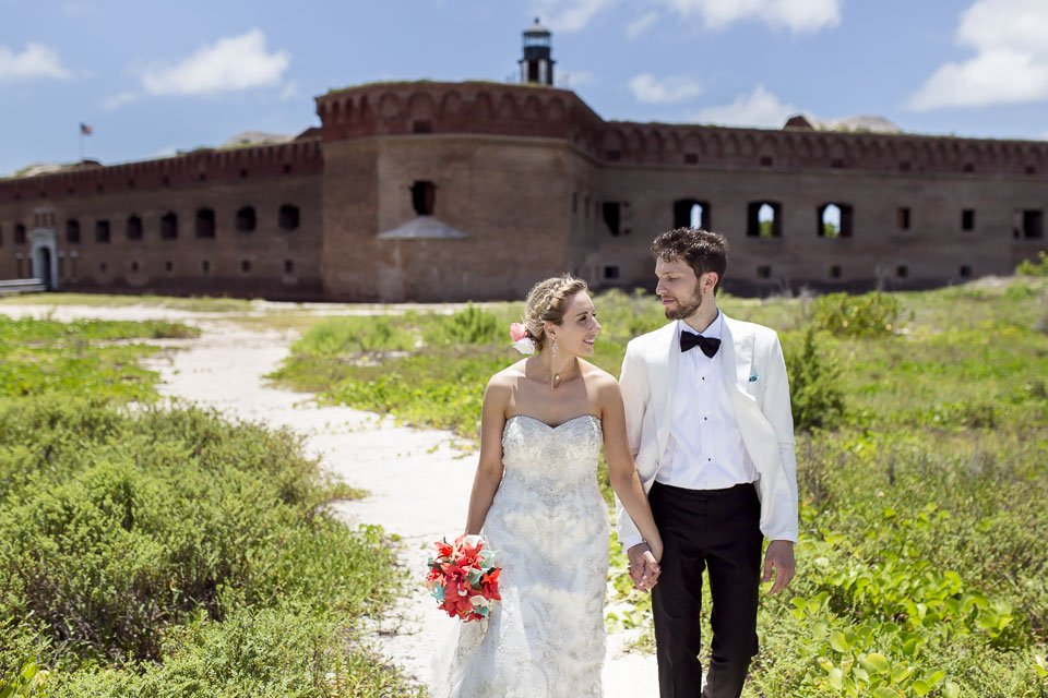 wedding photo with fort jefferson in the background